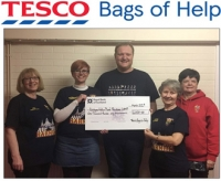 LAMP Committee accepting award of £1000 grant from Tesco Bags for Help